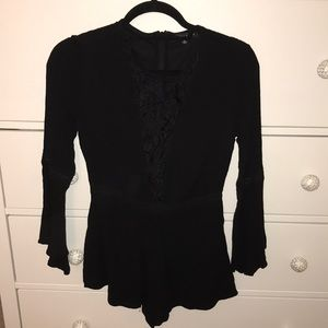 Kendall and Kylie long bell sleeve black romper